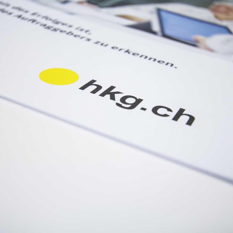 Umschlag Unternehmenbroschüre hkg.ch